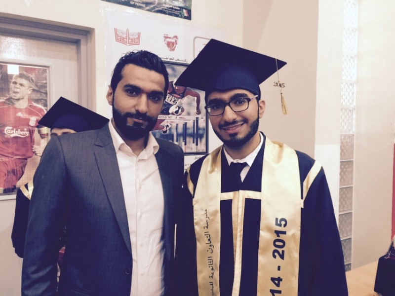 Mustafa Mohammed Ismael, right, with his brother Ali, at his graduation ceremony