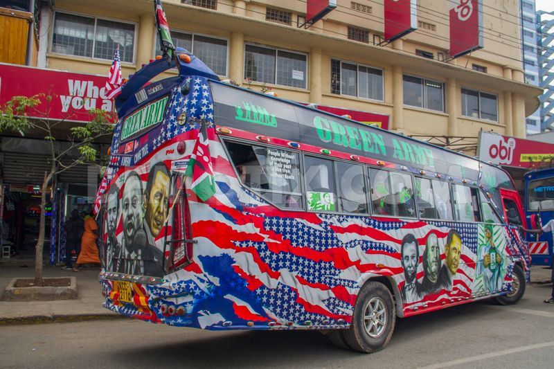 A matatu [local public transport] with American flag colours and the portraits of Abraham Lincoln, Martin Luther King Jr. and President Obama cruising Nairobi streets. Photo by Boniface Muthoni, copyright ©Demotix  (24/7/2015.