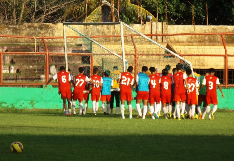Players lifting a goalpost. Photo by Arpan Rachman