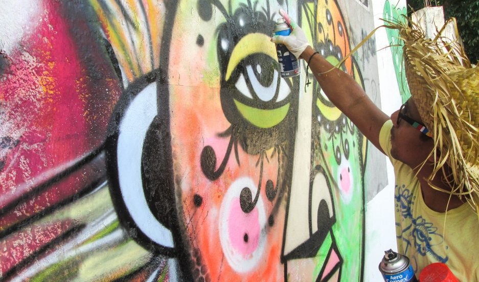 Graffiti artist Rei Blinky at work in San Pedro Sula, Honduras. Credit: Nathaniel Janowitz. Used with PRI's permission.