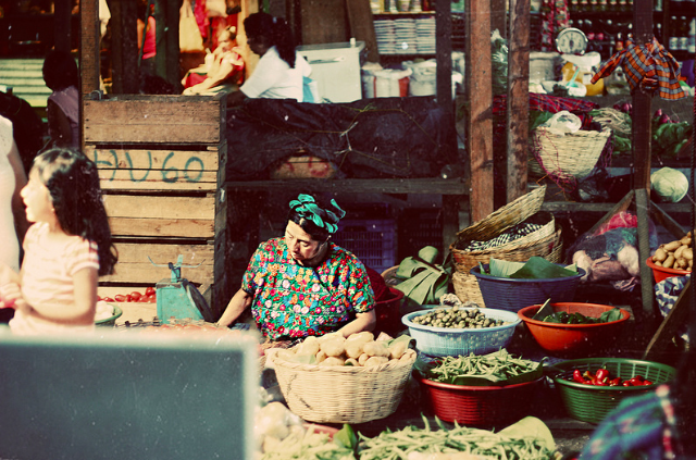 Thomas Frost Jensen Follow Woman in market  Antigua, Guatemala