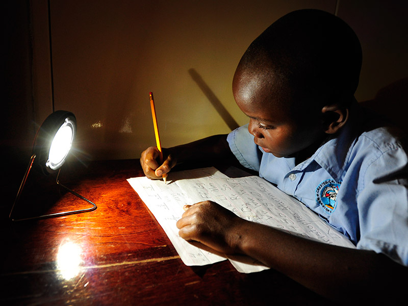 Reliable electricity is coming to more of Sub-Saharan Africa. In this photo, a student studies in Zambia. Photo by Flickr user SolarAid Photos. CC-BY-NC-SA 2.0