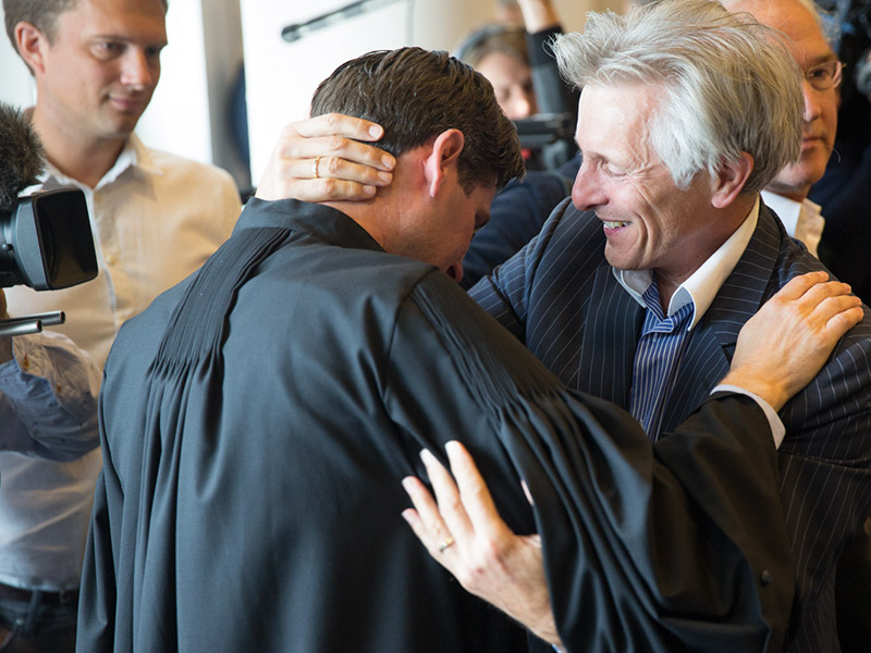 Urgenda lawyer Roger Cox (at left in black robe) after winning the historic Dutch climate case. Photo by Urgenda / Chantal Bekker and republished with permission.