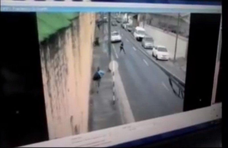 A screen grab of the escape video footage taken by a CCTV camera outside the Royal Gaol on Frederick Street, in Port of Spain, Trinidad. Video posted by Beyond the Tape's Facebook page.