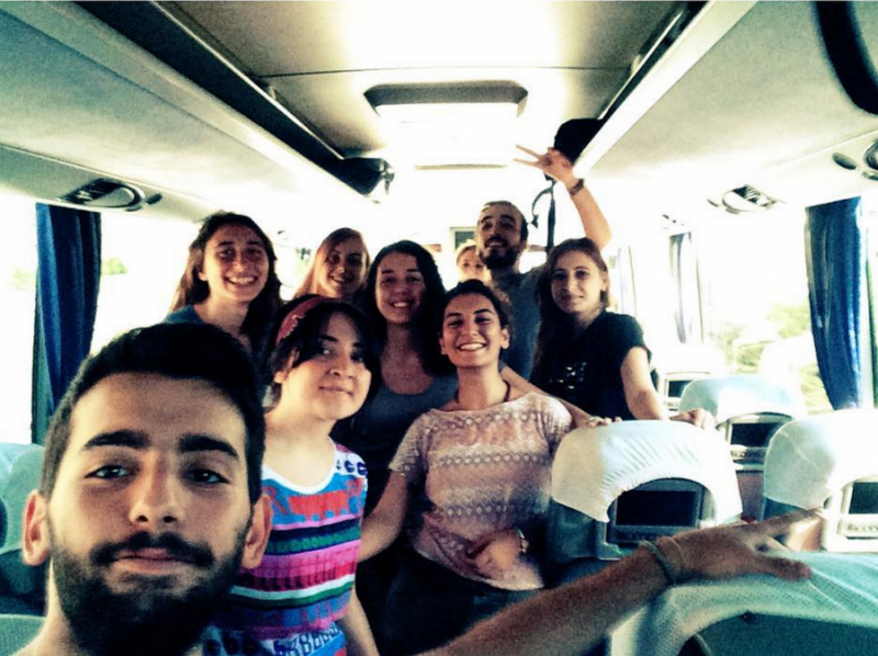 Hatice Ezgi Sadet is in the brown shirt, to the right, as she travels on the bus to Suruç with fellow activists. Credit: Hatice Ezgi Sadet's Instagram.