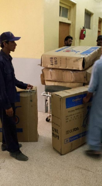 Five wheelchairs being delivered to Jinnah Hospital in Karachi. Photo from Junaid Akram's Facebook page.