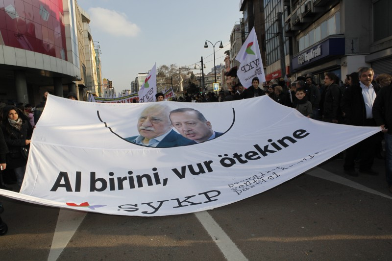 "In Istanbul a banner with Fethullah Gulen and PM Erdogan's pictures reads ""one is no better than the other"". Protesters rally to protest against corruption and planned construction projects. Demotix photo taken by Fulya Atalay. ID 3553279."