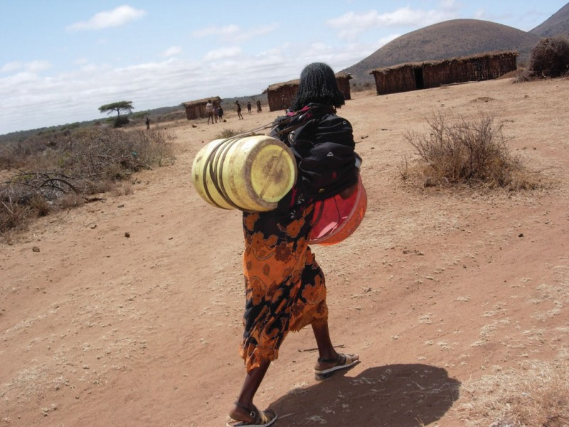 An Ethiopian woman carries a water barrel. Photo credit: 2006 Badadha Kule/IFPRI. CC BY-NC-ND 2.0