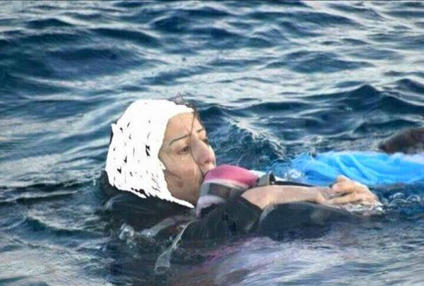 A photograph of reportedly a Syrian mother trying to swim to safety carrying her toddler child. Photo gone viral (source unknown)