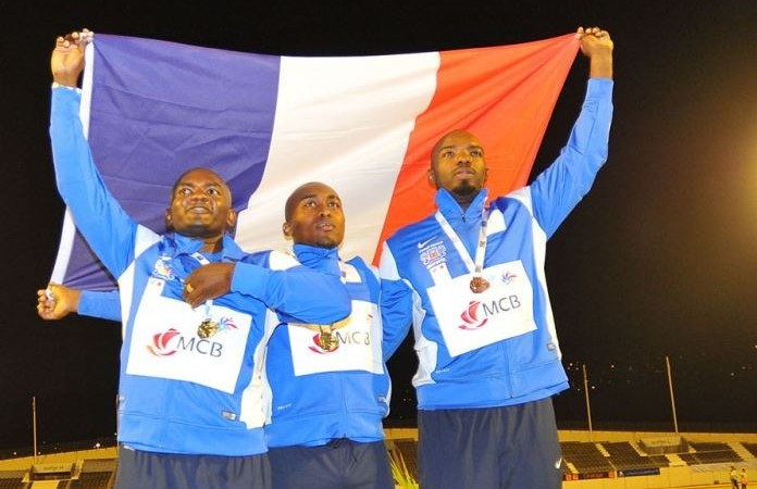 Screen Capture of  athletes from Mayotte raising the French flag at medal ceremony