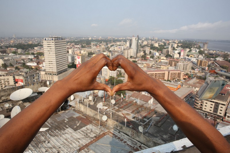 Kinshasa, DR Congo: A woman's hands make the heart-shaped logo of the World Day of dignity for victims of human trafficking, celebrated on 30 July. Photo by MONUSCO Photos; Photographer: Abel Kavanagh; used under a CC BY-SA 2.0 license.