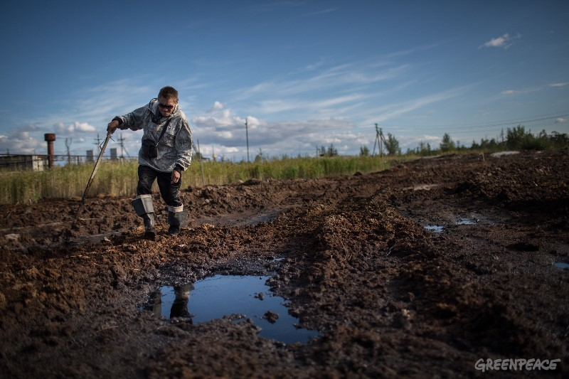 Sergey Kechimov shows the traces the oil companies left on Khanty land. Courtesy Denis Sinyakov/Greenpeace.