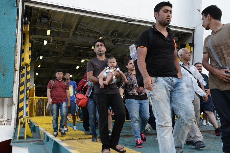 Piraeus, Greece. 21 August 2015 -- Syrian refugees, 2.176 in total, arrive at Piraeus harbor aboard the Eleftherios Venizelos, a special vessel chartered by the Greek government. Photo by Wassilis Aswestopoulos. Copyright Demotix