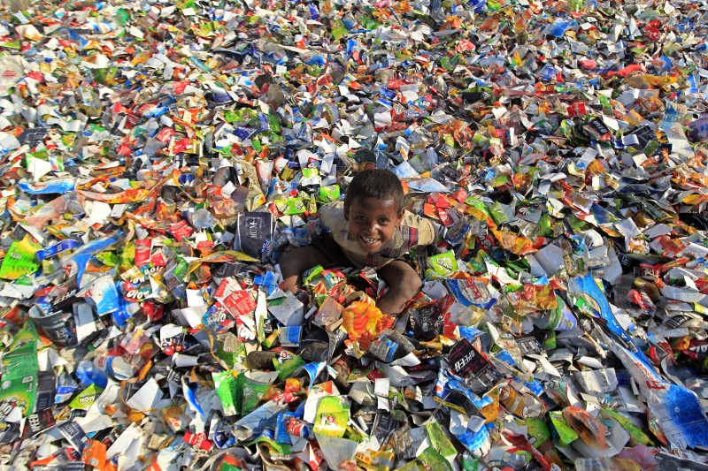 A street children play in the plastic dumps in Bangladesh. Photo by Md. Manik. Copyright Demotix (23/01/2014)