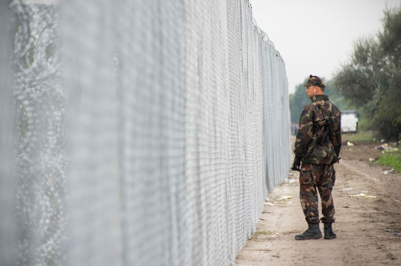Hungarian military seen patrolling the border beside the newly built fences to control the flow of refugees crossing into Hungary. Photo by Geovien So, copyright Demotix.