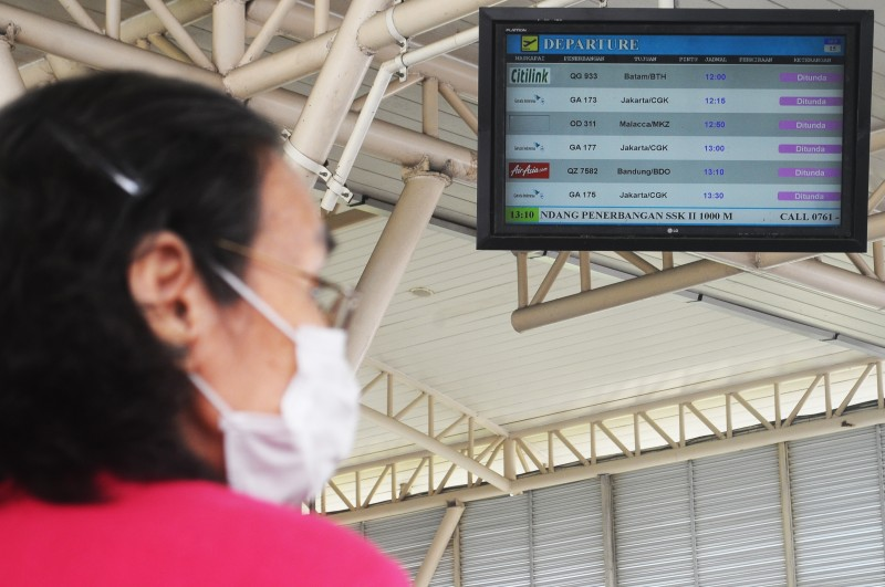 Thick haze covered Sultan Syarif Kasim II airport in Riau Province, Indonesia which resulted in the delay and cancellation of some domestic and international flights. Photo by Fachrozi Amri, Copyright @Demotix (9/15/2015)