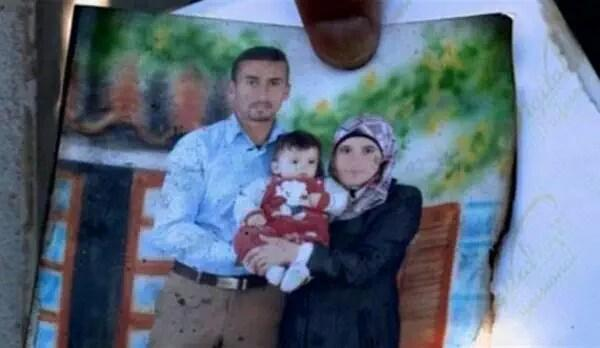 Eighteen-month-old Ali Al Dawabshen with his parents. Ali was burned to death in a settler attack on his West Bank home. His father died last week. His mother died last night. Both his parents and four-year-old brother were injured in the fire which killed him. Photograph shared by @LinahAlsaafin on Twitter