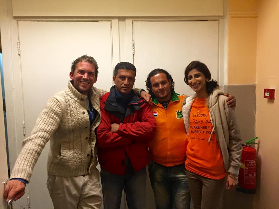 Two Iraq refugees who managed to escape after being captured by ISIS are flanked by a Dutch volunteer (L) and the author (R). PHOTO: Faten Busheri.