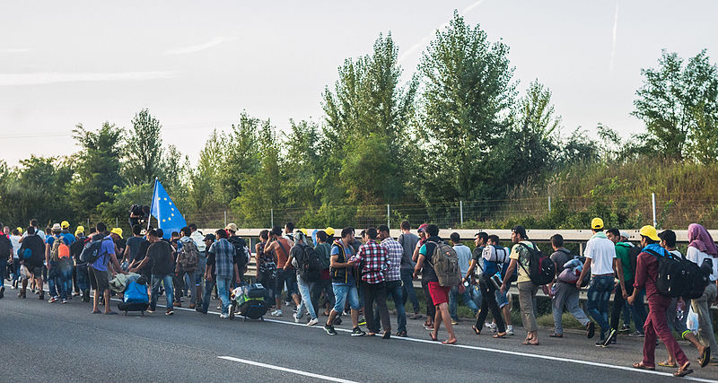 Refugees on Hungarian highway on their march towards the Austrian border. Photo released under Creative Commons by Joachim Seidler.