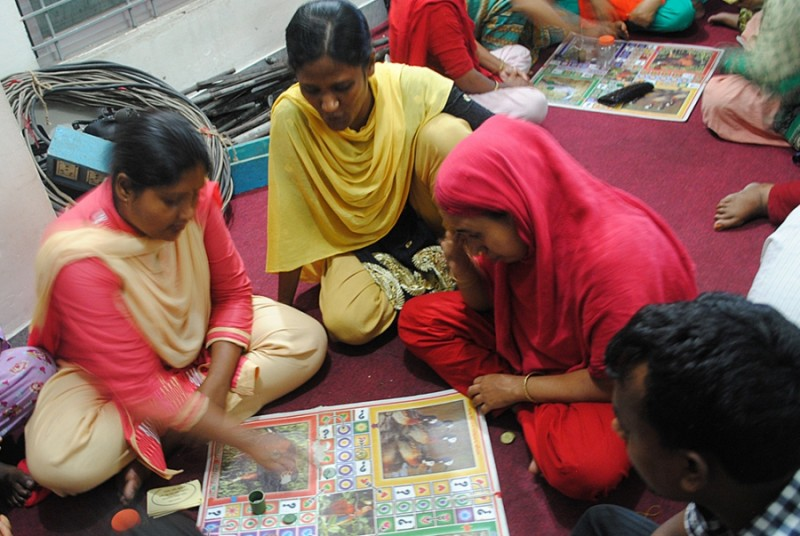 "Garment workers in Dhaka gather at a ""women's cafe"" after work to learn about workers' rights and responsibilities. Credit: Amy Yee. Used with PRI's permission"