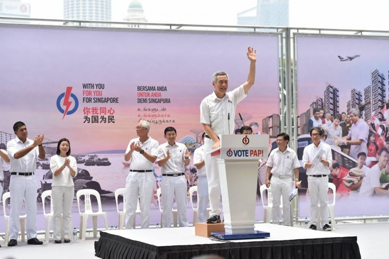 "Singapore's Prime Minister Lee Hsien Loong addresses a crowd in a campaign rally. The slogan of the ruling party is ""with you, for you, and for Singapore."" Photo from the Facebook page of People's Action Party."