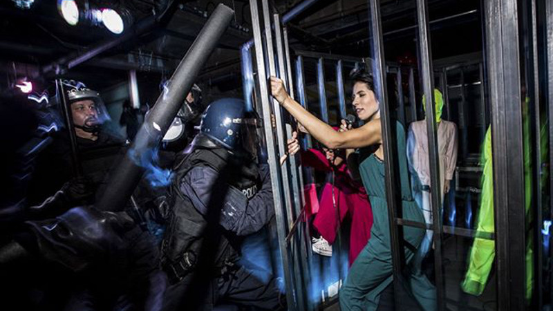 Punk group Pussy Riot perform in a cage on stage at Dismaland. Photo by Vianney Le Caer for Pussy Riot.