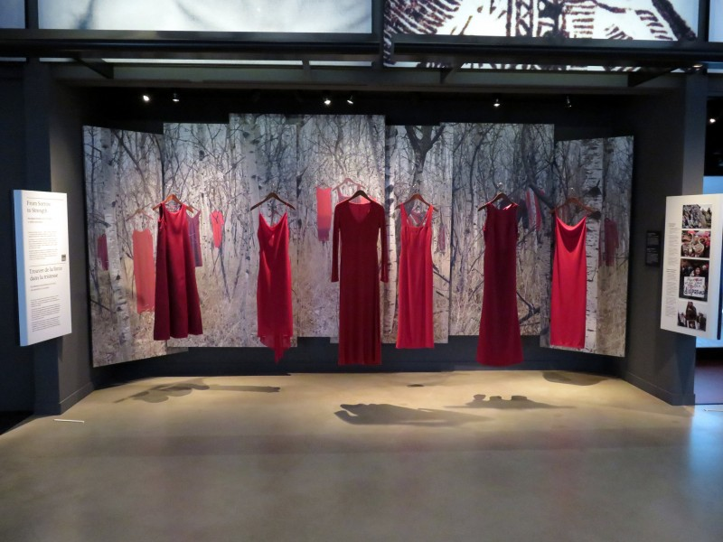 REDress Project installation: At the Canadian Museum of Human Rights; a response to over 1000 missing and murdered aboriginal women. Photo by Flicker user Sean_Marshall. CC BY-NC 2.0