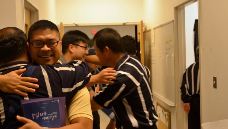 The Duranno Father School teaches stoic Korean dads how to be more involved and loving parents.  The program includes a literal lesson on how to hug.  Credit: Courtesy of the Duranno Father School