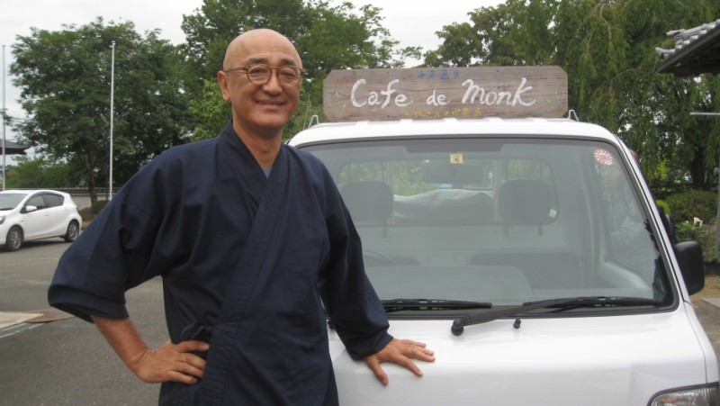 "Taio Kaneta with his signature ""Cafe de Monk"" truck that he uses for his pop-up cafes. As a Buddhist monk, Kaneta wanted to offer something special to those still reeling from the triple disaster of earthquake, tsunami and nuclear meltdown. Credit: Naomi Gingold. Used with PRI's permission"