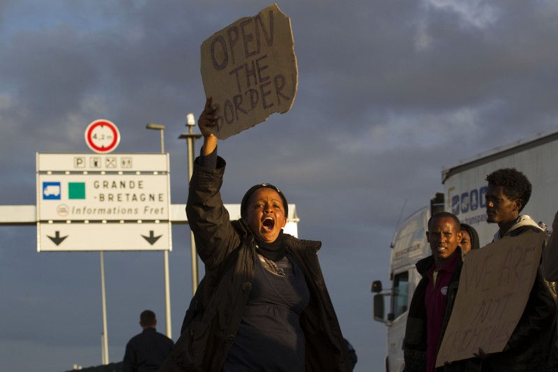 Migrants protest that UK open the border Calais Eurostar Terminal France. PHOTO © Jess Hurd/reportdigital.co.uk © Jess Hurd/reportdigital.co.uk Tel: 01789-262151/07831-121483 info@reportdigital.co.uk NUJ recommended terms & conditions apply. Moral rights asserted under Copyright Designs & Patents Act 1988. Credit is required. No part of this photo to be stored, reproduced, manipulated or transmitted by any means without permission.