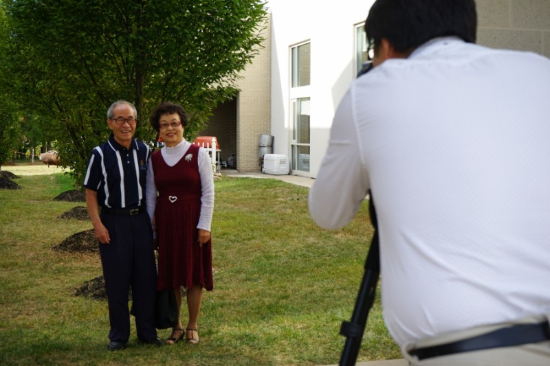 A couple poses for their graduation photo at the Duranno Father School.  Credit: Heidi Shin. Used with PRI's permission