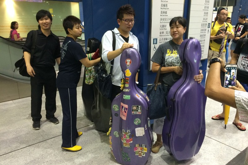 Miss Ng with her cello. Photo: HKFP.