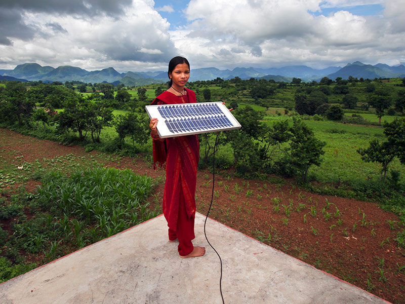 Meenakshi Dewan brings something very special to her home in Orissa, India: electricity. Photo by Flickr user DFID - UK Department for International Development. CC-BY-NC-SA 2.0