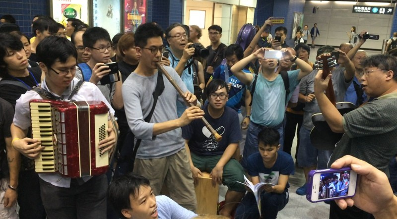 Musicians playing inside Tai Wai MTR station. Photo from HKFP.