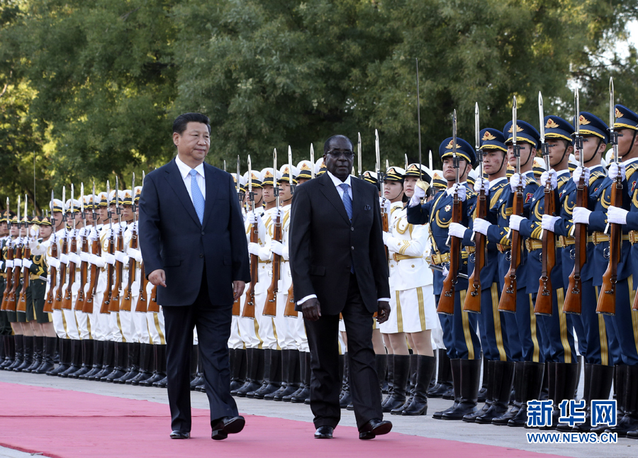 Chinese president Xi Jinping welcomed Zimbabwe President Mugabe's visit in August 2014. Photo from Xinhua.