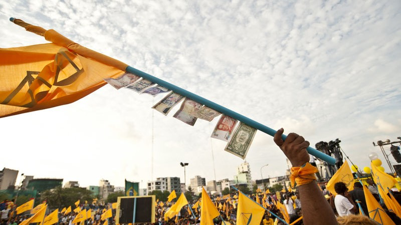 Protesters wave flags in a public square in Male. Image by Mohamed Muha. Copyright Demotix (17/2/2012)