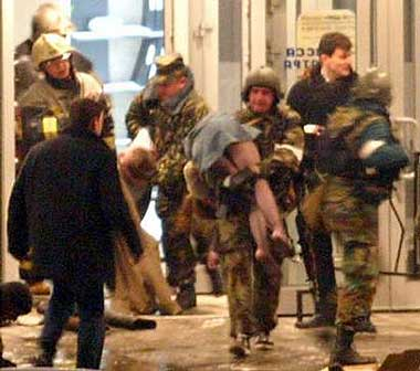 Screenshot from television footage of Nord-Ost Siege. Police remove gassed hostages. Circulated anonymously online.