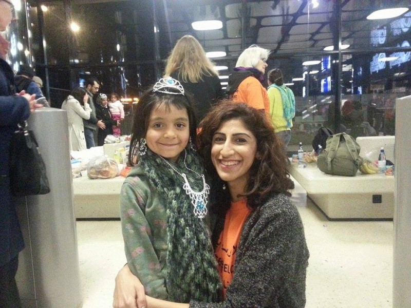 Faten Bushehri with a young refugee in Amsterdam (Photo credit: Lesvos  Refugee Emergency Aid.