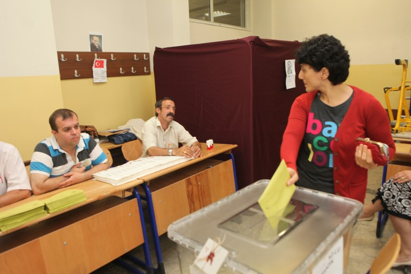 A woman votes in Turkey's last general election on 7 June, 2015. Photo by Sadik Gulec. Demotix ID 7795368.