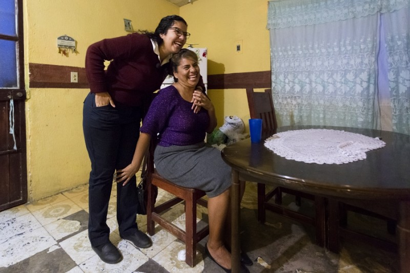 Before she leaves, Arlet's mother, Martha Flores Ibarra, arrives home at 6:30 am after working at one of the transnational maquiladora factories located in Ciudad Juarez. Credit: Miguel Gutierrez Jr./KUT News. Used with permission.