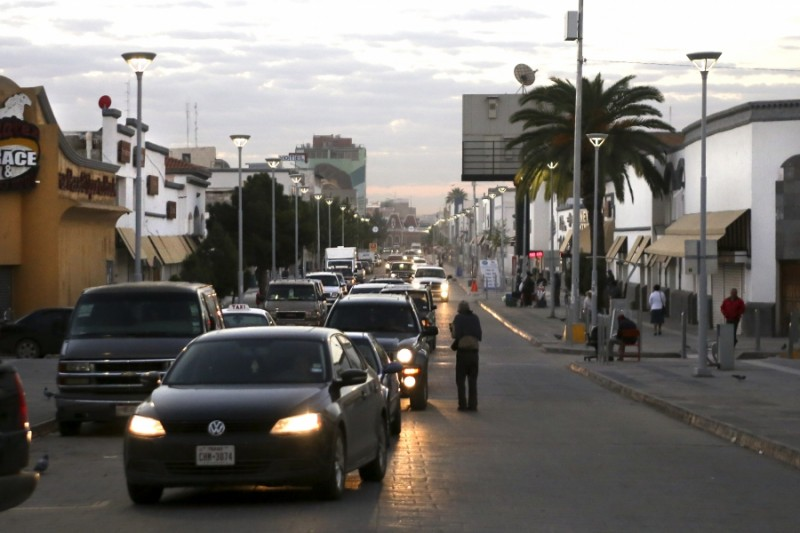 A line of cars forms down Calle Juarez in the early morning at the Puente Internacional Paso Del Norte. The cars are waiting to cross the bridge into El Paso, Texas. Credit: Miguel Gutierrez Jr./KUT News. Used with permission.