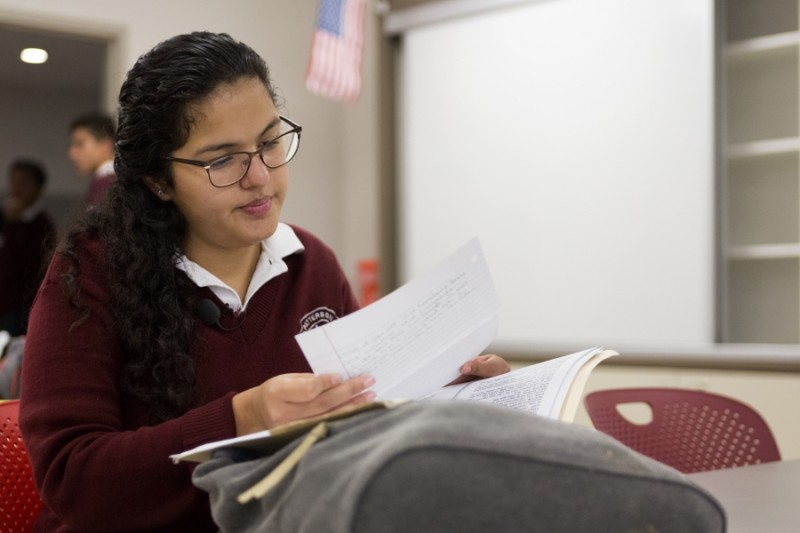 After breakfast, Arlet sits in her first period class, and looks over class materials.  Credit: Miguel Gutierrez Jr./KUT News. Used with permission.