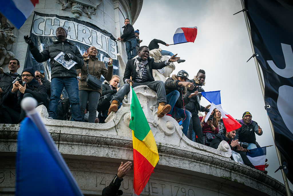 Paris rally in support of the victims of the 2015 Charlie Hebdo shooting, 11 January 2015. Photo by D B Young via Wikimedia Commons.