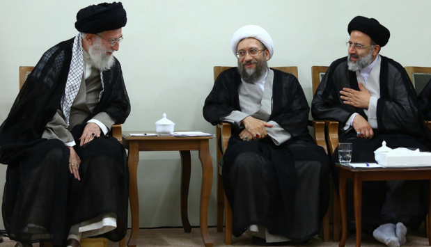 The Supreme Leader Ayatallah Khamenei sits in discussion with other prominent clerical figures, including Sadegh Larijani, the head of the Judiciary. Image from ICHRI.