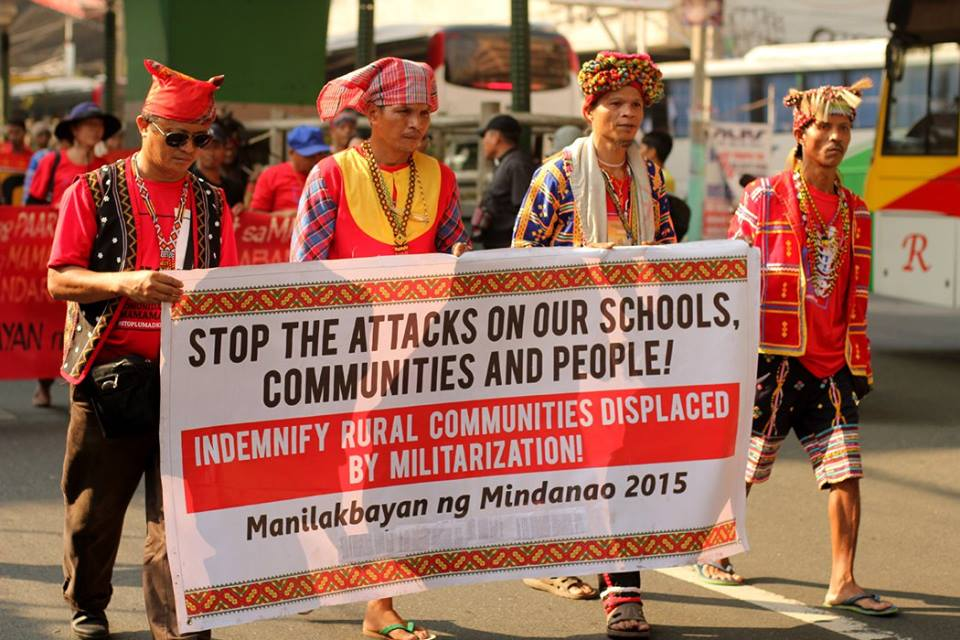 Lumad leaders display banner calling for the protection of their communities as they march towards Manila. Photo from the Facebook page of ST Exposure