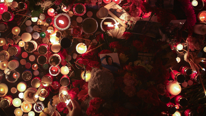 People lit candles and left flowers at Dvortsovaya Square in St. Petersburg on Sunday, November 1 during a day of national mourning for victims of a Metrojet crash over Egypt that killed all 224 on board. Photo by Nikolai Gontar for Demotix.