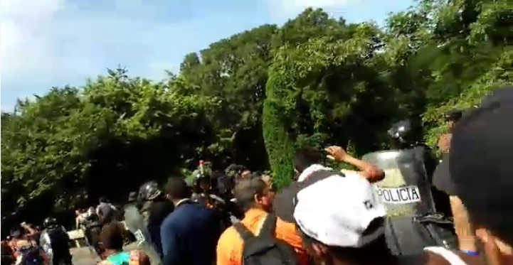 Screenshot of video posted by CB24.tv on Facebook showing Cuban migrants marching toward the border. Click the image to watch the video on Facebook.