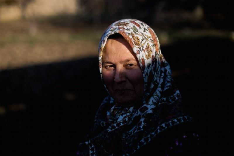 The wife of a migrant worker. She hasn't seen her husband in two years. Aravan village, Osh oblast.