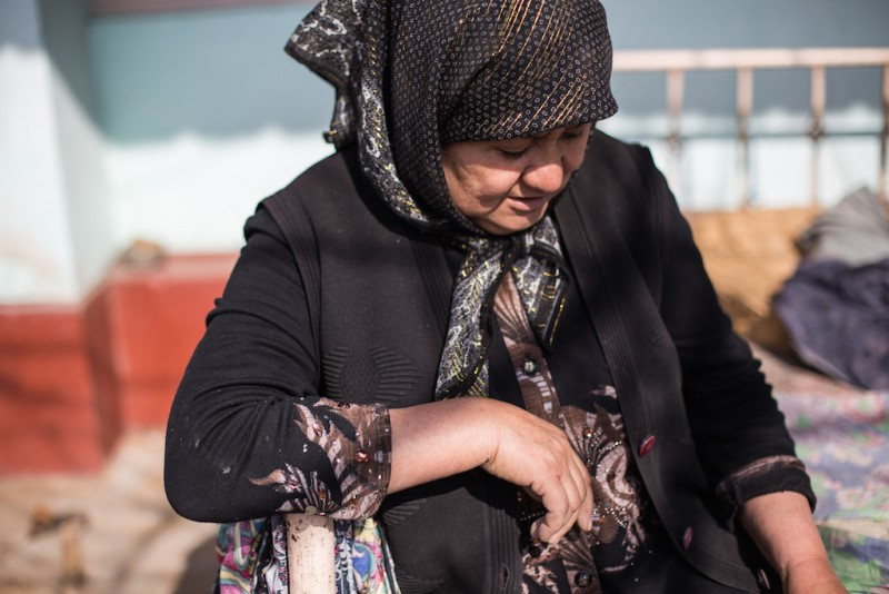 "Mahfirat, 60 years old, raises her three grandchildren. She receives a monthly state pension of 2,700 Kyrgyz soms [$40]. ""'Look at the moon. Your parents are looking back at youfrom there,' I say to the children. And then every time the moon is full, they look up..."" Osh city, Osh oblast."