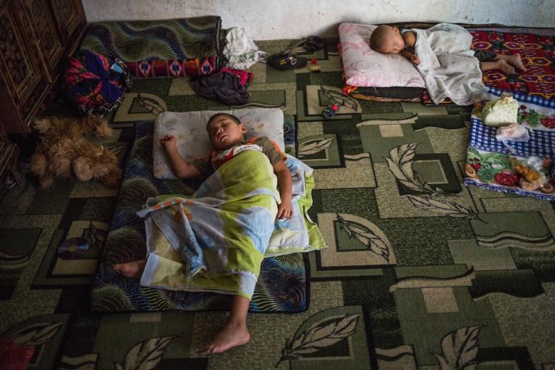 The children of migrant workers during a lunch break. Karabag village, Batken oblast.